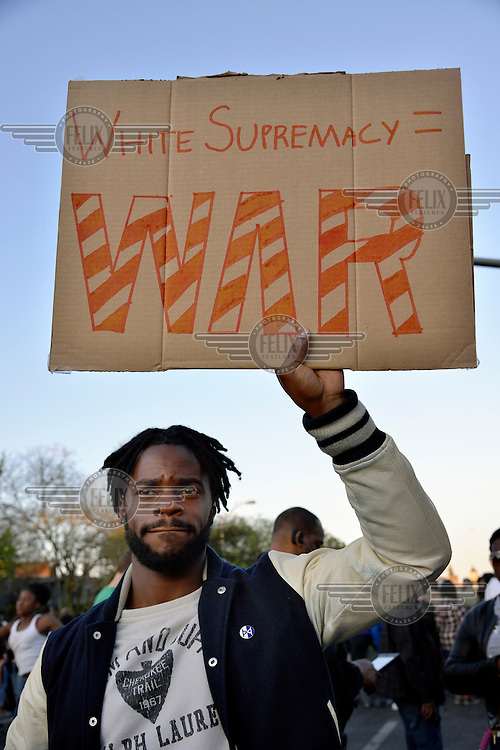 A man holds a placard at a protest following the death in custody of Freddie Gray in Baltimore. His placard reads: 'White supremacy = WAR'.<br /> After the violent riots and looting following the funeral of Freddie Gray who died after being arrested in Baltimore, people demonstrate against the excessive use of force by the local police force. <br /> Gray (25) was arrested in 12 April 2015 and died of spinal injuries a week after his arrest which was recorded on a mobile phone by a bystander.