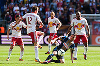 Sebastien Le Toux (11) of the Philadelphia Union and Eric Alexander (12) of the New York Red Bulls during a Major League Soccer (MLS) match at Red Bull Arena in Harrison, NJ, on March 30, 2013.