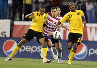 COLUMBUS, OHIO - SEPTEMBER 11, 2012:  Geoff Cameron (21) of the USA MNT bursts through Rodolph Austin (17) and Luton Shelton (21) of  Jamaica during a CONCACAF 2014 World Cup qualifying  match at Crew Stadium, in Columbus, Ohio on September 11. USA won 1-0.