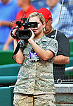 16 May 2012: Military journalist and Airman Natasha Yarbro from Joint Base Andrews captures video prior to a game between the Pittsburgh Pirates and the Washington Nationals at Nationals Park in Washington, DC. The Nationals defeated the Pirates 7-4 in the first game of their 2-game series. Mandatory Credit: Ed Wolfstein Photo