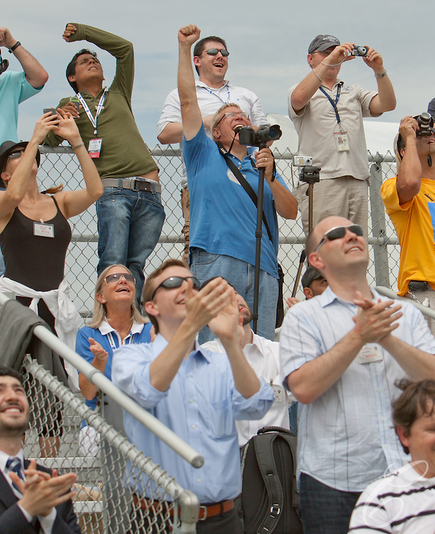 Spectators react as Space Shuttle Atlantis lifts off for the final time  from lunch pad 39A at Kennedy Space Center on Friday, July 8, 2011.  Atlantis' mission is the final one of the shuttle program's 30 year history and leaves NASA without manned spaceflight launch capability.