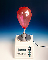 HELIUM BALLOON: LIFTING POWER<br /> Exerts A Lifting Force On A 100.00g Weight<br /> The balloon and the weight together weigh 99.75g.