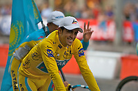 Yellow jersey winner, Alberto Contador, rides a victory lap of the Champs Elysees in Paris, during the 2010 Tour de France