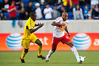 Thierry Henry (14) of the New York Red Bulls is marked by Tony Tchani (6) of the Columbus Crew. The New York Red Bulls and the Columbus Crew played to a 2-2 tie during a Major League Soccer (MLS) match at Red Bull Arena in Harrison, NJ, on May 26, 2013.