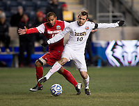 Harrison Shipp (10) of Notre Dame fights for the ball with Michael Calderon (11) of New Mexico during the NCAA Men's College Cup semifinals at PPL Park in Chester, PA.  Notre Dame defeated New Mexico, 2-0.