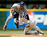 Seattle Mariners' Adrian Beltre, right,  breaks up a double play attempt by Detroit Tigers' second baseman Placido Polanco in the seventh inning of Major League Baseball game in Seattle on Sunday, July 6, 2008.  Jim Bryant Photo