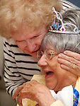 Photo by Phil Grout..Eleanor Smith gets a congratulatory hug from her friend Millie Murphy Erbe.during a party to celebrate Miss Eleanor's 100 birthday.  Friends and family.gathererd at the South Carroll Senior Center for the celebratiion.