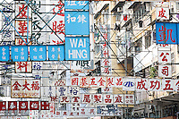Signs fill sky above street in Fabric Market, Kowloon, Hong Kong SAR, People's Repbulic of China, Asia