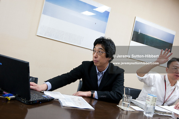 Masaaki Kanai (black suit) -President and Representative Director and Kei Suzuki (white shirt, glasses)- executive officer and general manager, of Muji in the Muji headquarters building, in Tokyo, Japan. Tuesday 27th April 2010.