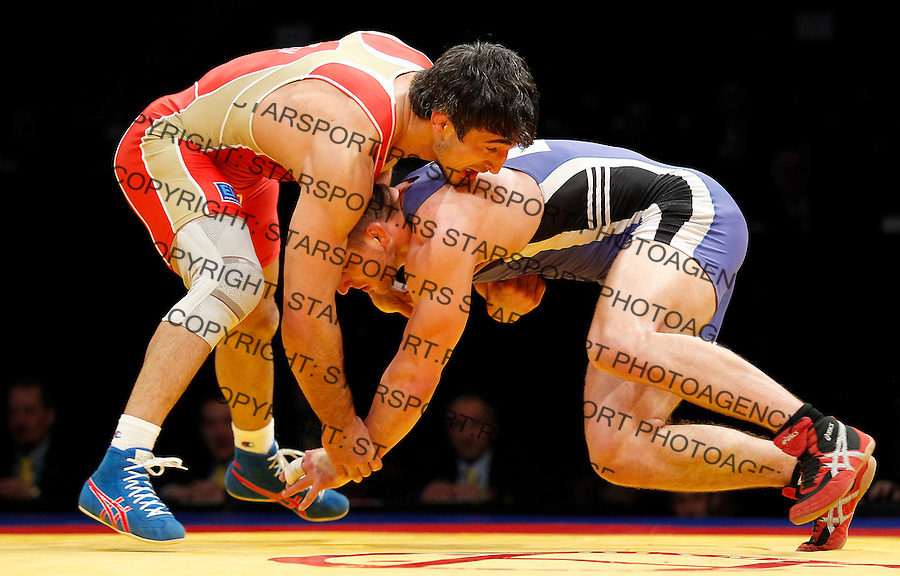 BELGRADE, SERBIA - MARCH 09: Anzor Urishev of Russia (L) fights with Armands Zvirbulis of Latvia (R) during Men`s  Freestyle 84 kg match for bronze medal at the European wrestling championship March 09, 2011 in Belgrade, Serbia.(Photo by Srdjan Stevanovic/Getty Images)