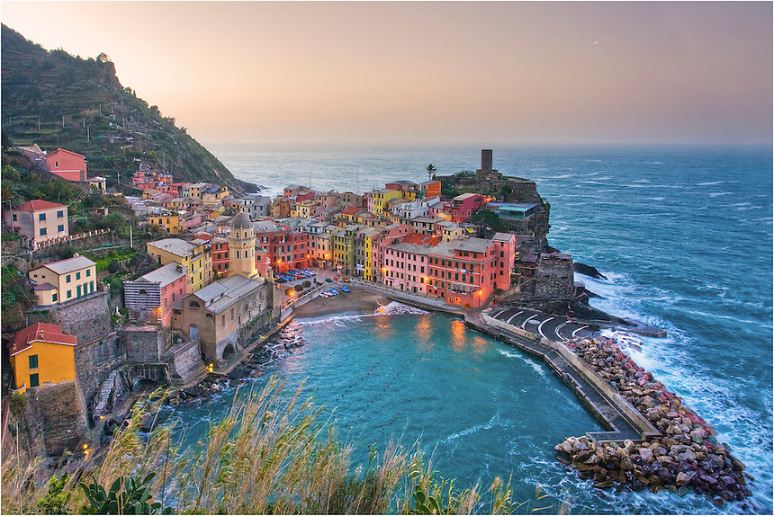 In the Cinque Terre, morning comes in shades of pink and blue and orange pastels. Vernazza, one of the most picturesque locations I've ever shot at, is lovely from the surrounding trails of the Cinque Terre National Park.