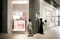 Qatar - Doha - Qataris shopping at The Pearl Qatar. The Peal has the most exclusive stores of town, including, Giorgio Armani and Hermes.