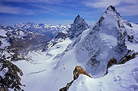 Matterhorn / Cervin and Dent d'Hérens rise dramatically over Tiefmatten glacier, Valais, Switzerland, 2011.