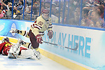 07 APR 2012:  Paul Carey (22) of Boston College is tripped up by goalie Taylor Nelson (29) of Ferris State University during the Division I Men's Ice Hockey Championship held at the Tampa Bay Times Forum in Tampa, FL.  Boston College defeated Ferris State 4-1 to win the national title.  Matt Marriott/NCAA Photos