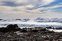A treacherously rocky beach complete with treacherous waves greets visitors to the California coast south of San Francisco.  Beauty in power.