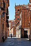 "A street with elaborate stone buildings in the historic downtown; buildings in Salamanca are made with sandstone that comes from the village of Villamayor; these stones have given Salamanca the nickname ""The Golden City"" or ""La Ciudad Dorada."""