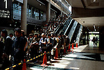 Thousands of manga fans line up hours before the start of a weekend manga comic market.  Such events bring together readers, independent and commercial manga artists, merchandisers, critics, publishers, and recruiters.  However, their principal audience tends to be those interested in the works of amatuer and independent manga artists producing non-mainstream works.