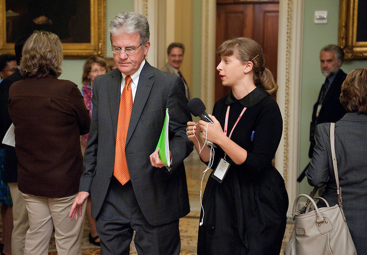 UNITED STATES - SEPTEMBER 7: Sen. Tom Coburn, R-Okla., speaks to a reporter as he walks through the Ohio Clock Corridor on Wednesday, Sept. 7, 2011.(Photo By Bill Clark/Roll Call)