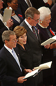United States President George W. Bush and First Lady Laura Bush stand next to the President's parents, former U.S. President George H.W. Bush and former First Lady Barbara Bush during the National Day of Prayer Service at the Washington National Cathedral in Washington, D.C. on Friday, September 14, 2001.  .Credit: Ron Sachs / CNP