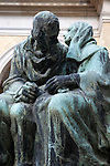 "A bronze statue of a couple in Vysehrad Cemetery in Vysehrad or the ""Castle on the heights,"" an area of Prague that includes a large fortress and park, Czech Republic, Europe"