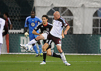 Colorado Rapids forward Conor Casey (9) shields the ball against DC United defender Dejan Jakovic (5).  DC United tied The Colorado Rapids 1-1, at RFK Stadium, Saturday  May 14, 2011.