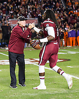 The tenth ranked South Carolina Gamecocks host the 6th ranked Clemson Tigers at Williams-Brice Stadium in Columbia, South Carolina.  USC won 31-17 for their fifth straight win over Clemson.  South Carolina Gamecocks head coach Steve Spurrier greats South Carolina Gamecocks defensive end Jadeveon Clowney (7)