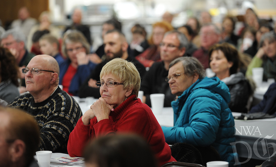 NWA Democrat-Gazette/ANDY SHUPE<br /> Members of the St. Joseph Catholic Church in Tontitown listen to a presentation by Donald Nohs, director general of the Confraternity of the Passion International, about the Should of Turin Saturday, Jan. 16, 2016, at the church.