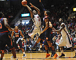 "Ole Miss' LaDarius White (10) scores vs. Auburn at the C.M. ""Tad"" Smith Coliseum on Saturday, February 23, 2013.  (AP Photo/Oxford Eagle, Bruce Newman)"