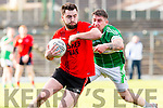 danny O'Sullivan Glenbeigh/Glencar goes past David Culloty Na Gaeil during the Junior Premier final in Fitzgerald Stadium on Sunday
