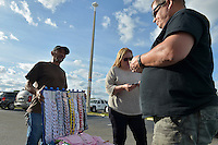 COCONUT CREEK, FL - OCTOBER 25: A vendor sells campaign merchandise before a rally to support Democratic presidential nominee former Secretary of State Hillary Clinton and highlight the start of in-person early voting at Omni Auditorium, Broward College North Campus on October 25, 2016 in Coconut Creek, Florida. With two weeks to go until Election Day, Clinton will urge Florida voters to take advantage of in-person early voting, which begins in many Florida counties. Credit: MPI10 / MediaPunch