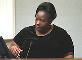 Tina Leonard, of Baton Rouge, Louisiana, gestures during her testimony in the trial of sniper suspect John Allen Muhammad in courtroom 10 at the Virginia Beach Circuit Court in Virginia Beach, Virginia on October 27, 2003. Leonard identified a photo of Lee Boyd Malvo as a person she saw at a shooting in Baton Rouge in September of 2002. <br /> Credit: Davis Turner - Pool via CNP