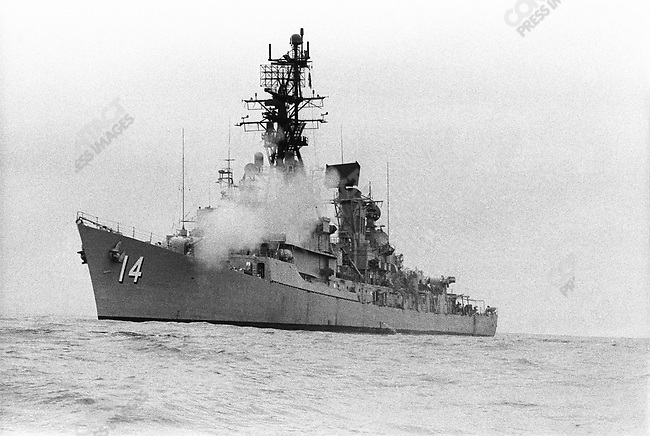 A US navy destroyer shooting 5 inch shells into North Vietnam just north of the DMZ, approximately one week before the start of the Easter Offensive, Vietnam March 1972
