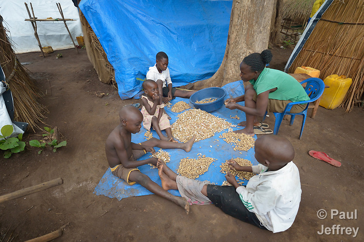 Mariana David and her children shell peanuts in a camp for for than 5,000 displaced people in Riimenze, in South Sudan's Gbudwe State, what was formerly Western Equatoria. Families here were displaced at the beginning of 2017, as fighting between government soldiers and rebels escalated.<br /> <br /> Two Catholic groups, Caritas Austria and Solidarity with South Sudan, have played key roles in assuring that the displaced families here have food, shelter and water.