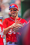 26 July 2013: Washington Nationals outfielder Bryce Harper smiles in the dugout prior to a game against the New York Mets at Nationals Park in Washington, DC. The Mets shut out the Nationals 11-0 in the first game of their day/night doubleheader. Mandatory Credit: Ed Wolfstein Photo *** RAW (NEF) Image File Available ***