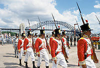 Carnival parade in costumes for celebrations at Sydney Opera House by Sydney Harbour Bridge for Australia's Bicentenary,1988