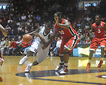 Ole Miss guard Nick Williams (20) drives the lane as Georgia's Jeremy Price (50) defends at the C.M. &quot;Tad&quot; Smith Coliseum in Oxford, Miss. on Saturday, January 15, 2011. Georgia won 98-76.  (AP Photo/Oxford Eagle, Bruce Newman)