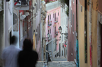 Steep narrow street with colourful painted houses in the old town of Lisbon, Portugal. Picture by Manuel Cohen