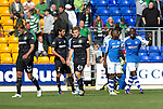 St Johnstone v Celtic....15.09.12      SPL  .Nigel Hasselbaink and Gregory Tade celebrates victory at full time as Celtic's Thomas Rogne, James Forrest and Lassad Nouioui trudge off.Picture by Graeme Hart..Copyright Perthshire Picture Agency.Tel: 01738 623350  Mobile: 07990 594431