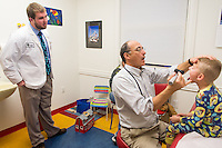 Joshua Price, class of 2015, left, Joe Nasca, M.D., James Schuller, release 20121116007.