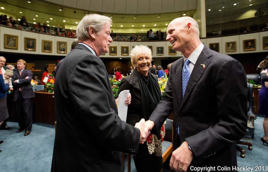 TALLAHASSEE, FLA. 3/5/13-OPENING030513CH-Gov. Rick Scott, right, greets Sen. John Thrasher, R-St. Augustine, during the opening day of the 2013 legislative session Tuesday at the Capitol in Tallahassee, Fla...COLIN HACKLEY PHOTO