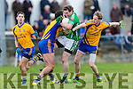 Man of the Match Ronan Murphy Beaufort stops Milltown Castlemaine legend Mike Burke in his tracks during the Mid Kerry final in Killorglin on Sunday
