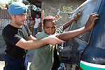 An East Timorese men is detained with two of his frriends by Portugese Police (GNR) after having a weapon, a viscous looking club with nails, found in their possession. The police set up a roadblock in Bairo Pitie, a area in Dili notorious for gang violence, after a clash involving stone throwing gang members and incidents of arson where a number of houses were set on fire.