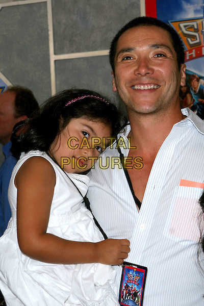 """24 July 2005 - Hollywood, CA - Benito Martinez and family. World premiere of """"Sky High"""" held at The El Capitan Theatre..Photo credit: Jacqui Wong/AdMedia"""