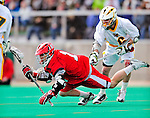 19 March 2011: St. John's University Red Storm Attacker Keith Switzer, a Freshman from Hillsdale, NJ, is checked during game action against the University of Vermont Catamounts at Moulton Winder Field in Burlington, Vermont. The Catamounts defeated the visiting Red Storm 14-9. Mandatory Credit: Ed Wolfstein Photo