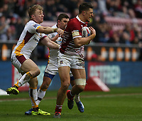 Wigan Warriors' Anthony Gelling is tackled by Huddersfield Giants' Danny Brough and Aaron Murphy (left) <br /> <br /> Photographer Stephen White/CameraSport<br /> <br /> Betfred Super League Round 5 - Wigan Warriors v Huddersfield Giants - Sunday 19th March 2017 - DW Stadium - Wigan<br /> <br /> World Copyright &copy; 2017 CameraSport. All rights reserved. 43 Linden Ave. Countesthorpe. Leicester. England. LE8 5PG - Tel: +44 (0) 116 277 4147 - admin@camerasport.com - www.camerasport.com