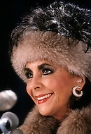 """Helmsley Palace Hotel, New York - January 14, 1987. This portrait of Elizabeth Taylor was taken at the press conference held by the Cheseborough Pond Company for the actress's new fragrance, Elizabeth Taylor's Passion. Elizabeth """"Liz"""" Taylor (February 27, 1932 – March 23, 2011) was a British-American actress, who became one of the great screen actresses of Hollywood's Golden Age."""
