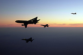 Afghanistan - December 7, 2009 -- F/A-18F Super Hornets assigned to the Black Aces of Strike Fighter Squadron (VFA) 41 and F/A-18E Super Hornets assigned to the Tophatters of VFA-14 refuel Monday, December 7, 2009 from an Air Force KC-10 Extender tanker aircraft over Afghanistan. The strike fighter squadrons are part of the Nimitz Carrier Strike Group and are on a deployment to the U.S. 5th Fleet area of responsibility supporting Operation Enduring Freedom. .Mandatory Credit: Kyle Terwilliger - U.S. Navy via CNP.