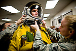 "U2 pilot Major Eric Shontz is helped into his pressurized flight suit before a ""high-flight"" at Beale Air Force Base February 24, 2010 in Linda, Calif."