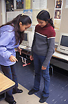 Berkeley CA 5th grade Latina girls conducting a flight experiment during science time in class