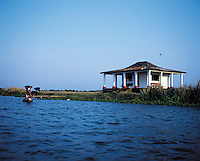 The Papaloapan river which runs by Tlacotalpan veracruz, 2002. The colonial port of Tlacotalpan is one of the best preserved small cities in mexico, it was declared a World Heritage town.  It is also the epicenter of the Cuban-Spanish influenced  Son Jarocho music.